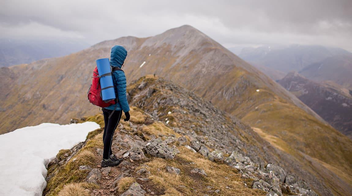 Teen hiking a mountain to overcome depression symptoms