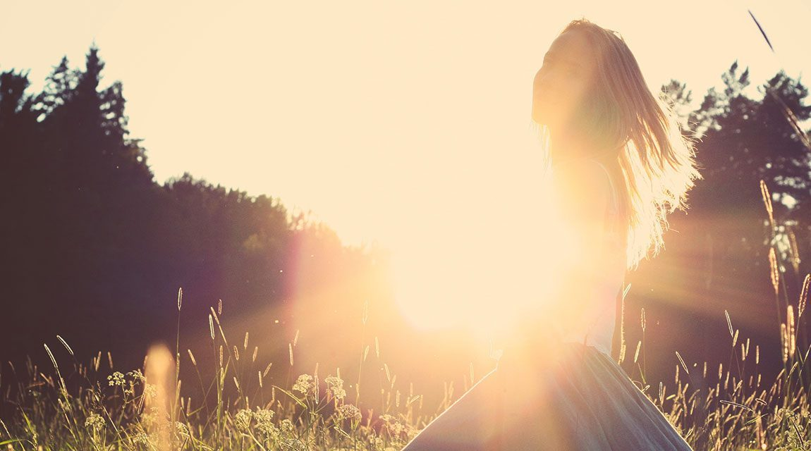 Teen in the sunlight practicing positive thinking