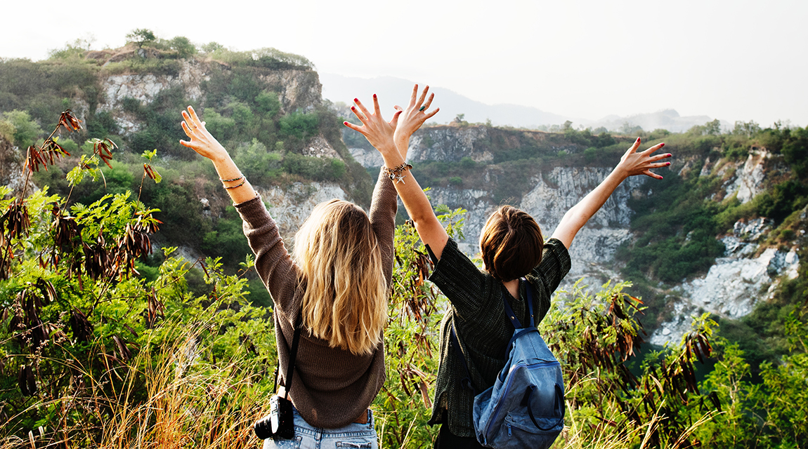 Girls with Their Arms Up for Adventure Based Therapy