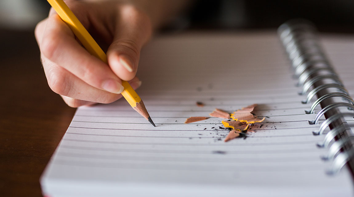 Learning Disability Diagnosis - Teen Writing in Notebook