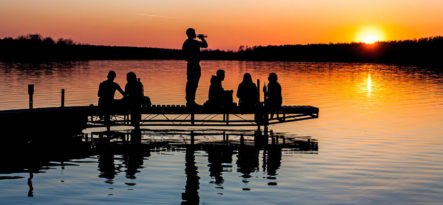 Teen drinking taking place on a dock