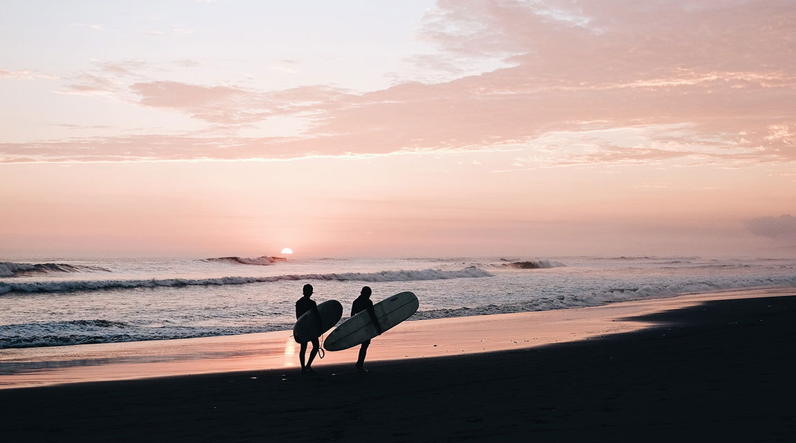 Adolescents surfing by the beach as a healthy alternative activity to teenage drug abuse