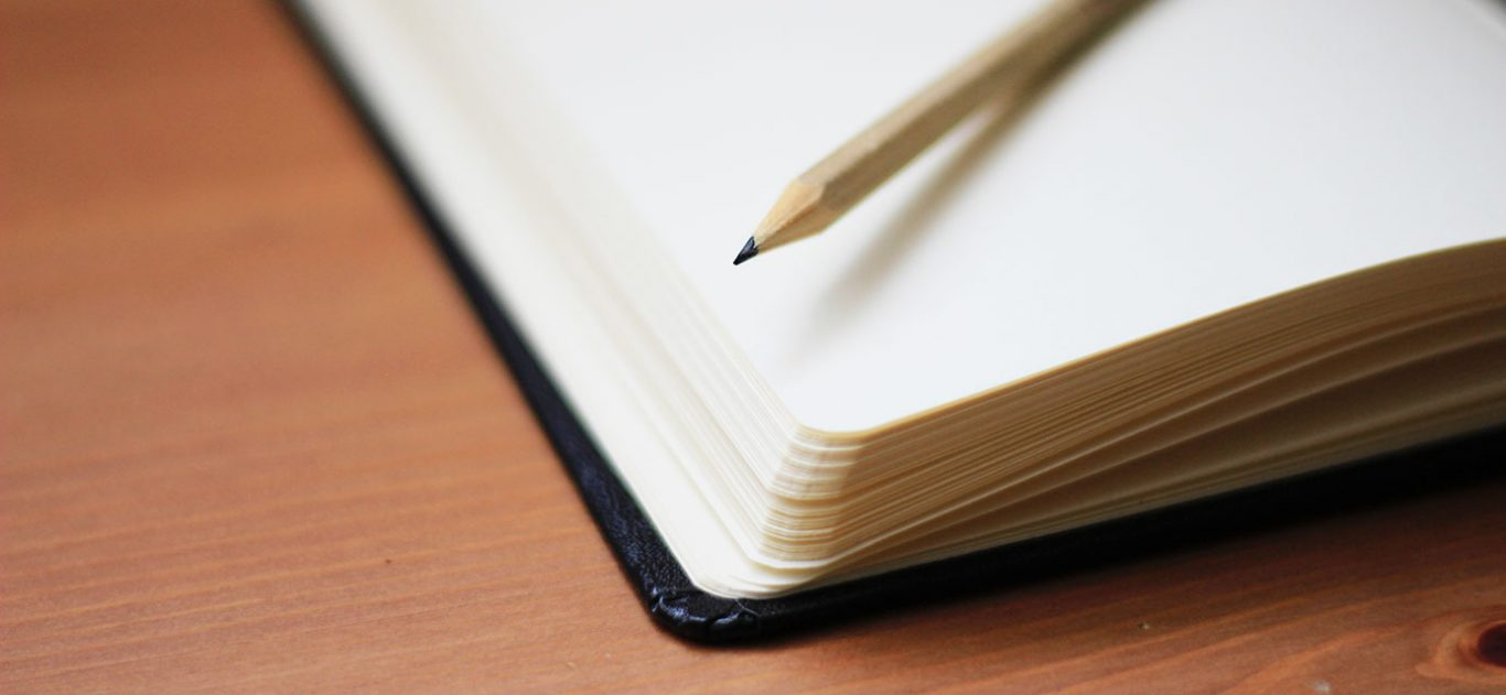 Journal with pencil