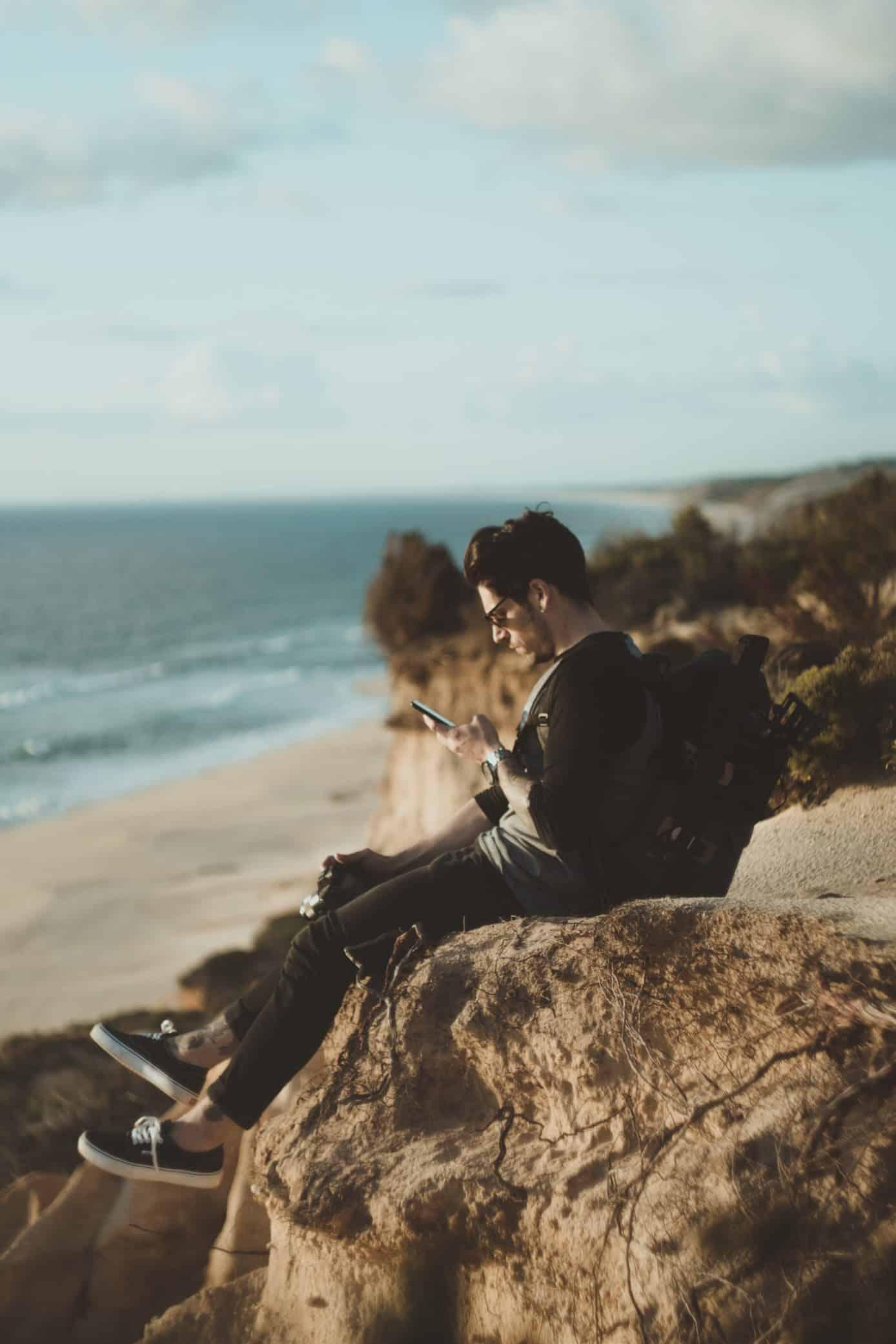 WELL + GOOD:Boy_Beach_Texting_Newport_Academy